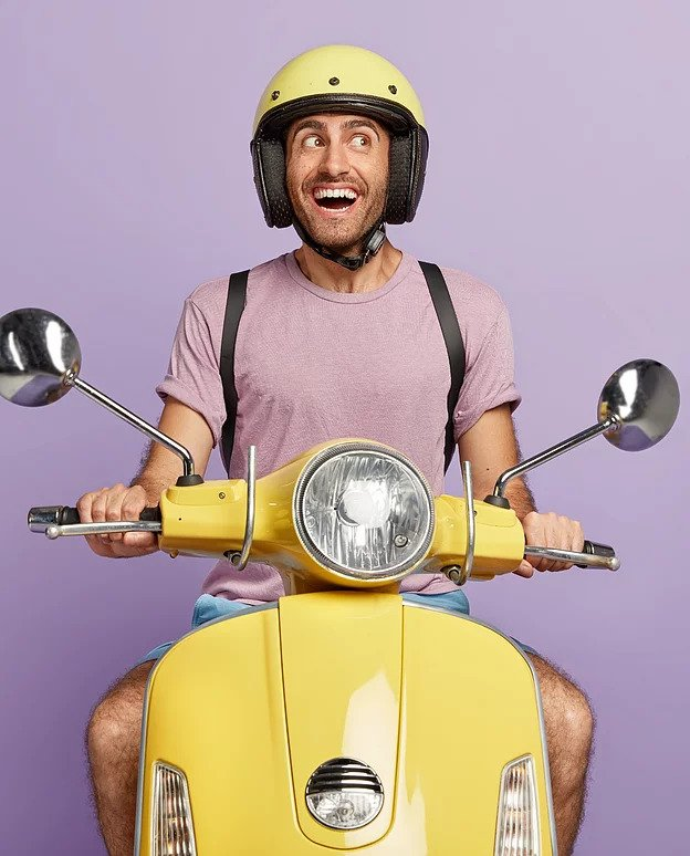 happy male biker courier drives yellow s